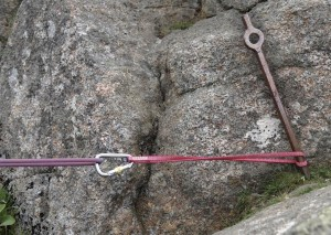 A metal spike tied off low down to reduce the leverage on the spike. You can either clove hitch the sling to the spike or wrap the sling round the spike so it prevents the sling sliding upwards.