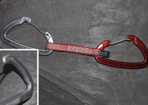 Red for rope or clip the rope into the captivated eye end. Either way you need to have a way to ensure you clip the rope into the same end of the quickdraw to avoid damage that might be done by a bolt or metal gear.