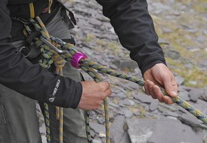 Belay on double ropes. Here the climber can pay out one or both rope by using his thumb to control the live ropes. They can also take in either by controlling what rope(s) they are using with the dead rope by splitting the ropes. (see next photo)